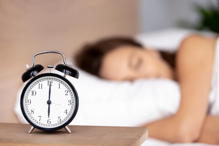 Woman Sleeping with Clock